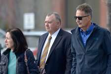 Former New Milford Information Technology director Kendrick Protzmann, center, leaves Litchfield Judicial District Courthouse at Torrington Friday morning, January 24, 2020, in Torrington, Conn.