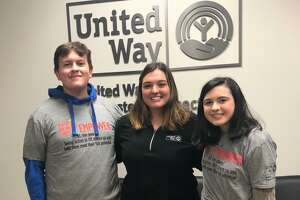 From left to right: Connor Parille, Ethic of Service Award recipient; Morgan Browne, YVC program director; and Emma Kiernan, Ethic of Service Award recipient. Connor and Emma both completed 500 hours of service with Youth Volunteer Corps.