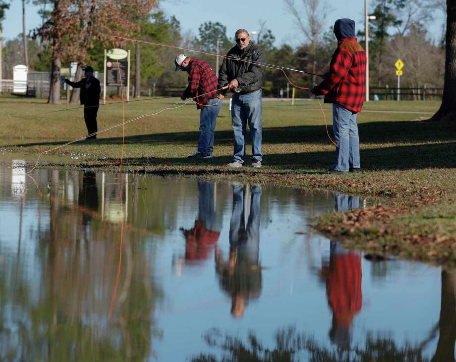 Army veteran Alan Corder, center, helps fellow Army veteran Carolyn Rhodes learn to fly fish as members of the Conroe Fly Fishers met to fish at Carl Barton, Jr. Park, Thursday, Jan. 23, 2020, in Conroe. The organization mets twice a month and is a part of the national nonprofit, Project Healing Waters Fly Fishing, which helps 8,300 disabled veterans nationwide with various treatments. Photo: Jason Fochtman, Houston Chronicle / Staff Photographer / Houston Chronicle © 2020