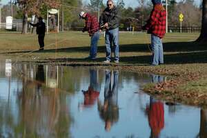 Army veteran Alan Corder, center, helps fellow Army veteran Carolyn Rhodes learn to fly fish as members of the Conroe Fly Fishers met to fish at Carl Barton, Jr. Park, Thursday, Jan. 23, 2020, in Conroe. The organization mets twice a month and is a part of the national nonprofit, Project Healing Waters Fly Fishing, which helps 8,300 disabled veterans nationwide with various treatments.