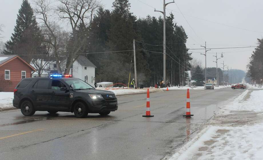"Personnel with the Big Rapids Department of Public Safety set up traffic barricades in the area of Bjornson Street and Darwin Avenue as well as Milton and Dekrafft avenues as DTE Energy crews worked to repair a ""significant"" gas leak Friday afternoon. Photo: (Pioneer Photo/Taylor Fussman)"