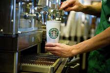 Starbucks barista making coffee.