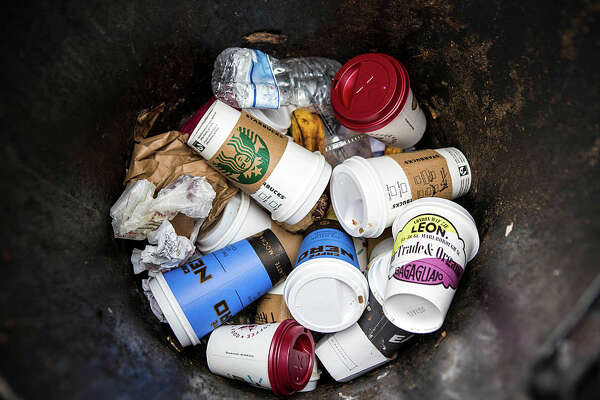 Coffee cups make up the majority of the contents of a street rubbish bin in central London. (Photo by In Pictures Ltd./Corbis via Getty Images)