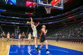The Bad Axe girls basketball team competes against Vassar at Little Caesar's Arena Jan. 24.