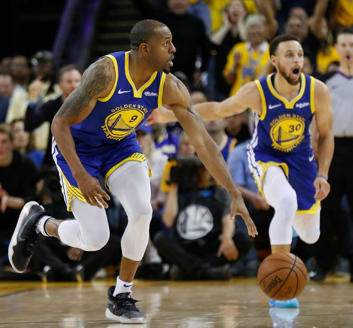 Golden State Warriors Andre Iguodala and Stephen Curry react to a foul call against Iguodala in the fourth quarter during game 5 of the Western Conference Playoffs between the Golden State Warriors and the Los Angeles Clippers at Oracle Arena on Wednesday, April 24, 2019 in Oakland, Calif.