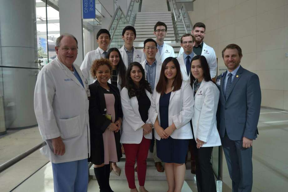 Texas A&M medical students participating in the Houston Methodist Willowbrook site program pose for a photo with Houston Methodist Education Institute leaders. (From left to right) Front: Dr. Timothy Boone, Amy Wright, Sara Yasrebi, Tam Tran Nguyen, Teresa Tran, Trevor Burt; Middle: Nivetha Chandrasekaran, Caleb Shin, Noah Giese; Back: Ryan Jang, William Choi, Michael Buchholz, Jacob Moser. Photo: Courtesy Of Houston Methodist Willowbrook Hospital / Submitted