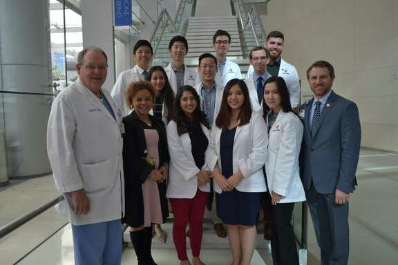 Texas A& medical students participating in the Houston Methodist Willowbrook site program pose for a photo with Houston Methodist Education Institute leaders. (From left to right) Front:Dr. Timothy Boone, Amy Wright, Sara Yasrebi, Tam Tran Nguyen, Teresa Tran, Trevor Burt; Middle:Nivetha Chandrasekaran, Caleb Shin, Noah Giese; Back:Ryan Jang, William Choi, Michael Buchholz, Jacob Moser.
