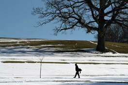 Jada Mane of Albany keeps his golf swing in tune over the winter months with a snowy outing at Frear Park on Friday afternoon, Jan. 24, 2020, in Troy, N.Y. (Will Waldron/Times Union)