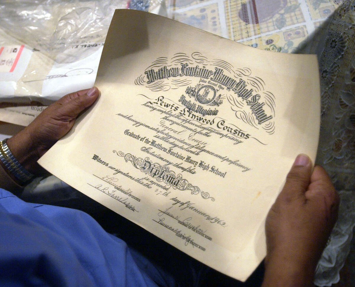 Louis Cousins looks Tuesday evening Feb. 10, 2004 at his diploma from Maury High School. Cousins was one of the Norfolk 17, 17 black students who integrated Norfolk, Va. schools in 1959. (WILLIAM LUTHER/STAFF)
