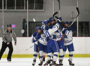 Darien players celebrate one of their four first period goals during their boys hockey game with Fairfield Prep at the Darien Ice Rink in Darien, Conn. on Monday January 19, 2020.
