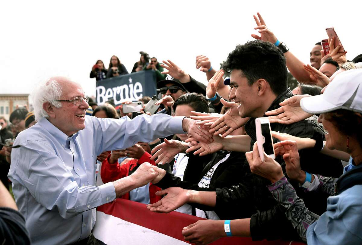 Democratic presidential candidate Sen. Bernie Sanders, I-Vt., greets supporters after finishing his remarks during a rally at Great Meadow Park at Fort Mason in San Francisco, Calif., on Sunday, March 24, 2019.