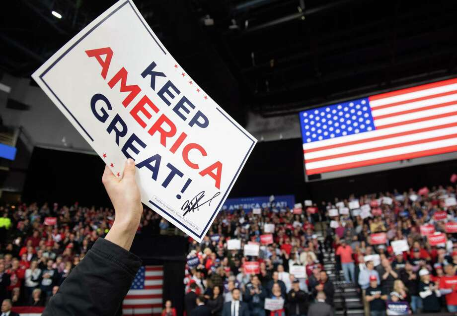 """A Trump supporter holds a """"Keep America Great"""" sign at a campaign rally in Toledo, Ohio, Jan. 9. A reader says voting for Trump in 2020 seems like the only option. Photo: SAUL LOEB /AFP Via Getty Images / AFP or licensors"""