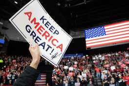 """A Trump supporter holds a """"Keep America Great"""" sign at a campaign rally in Toledo, Ohio, Jan. 9. A reader says voting for Trump in 2020 seems like the only option."""