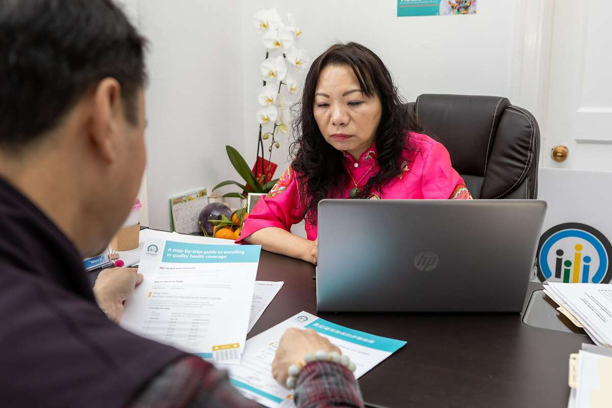 Certified insurance agent for Covered California Isabella Ku (right) speaks to Eason Lee about health insurance options at her office on Friday, Jan. 24, 2020, in San Francisco, CA.
