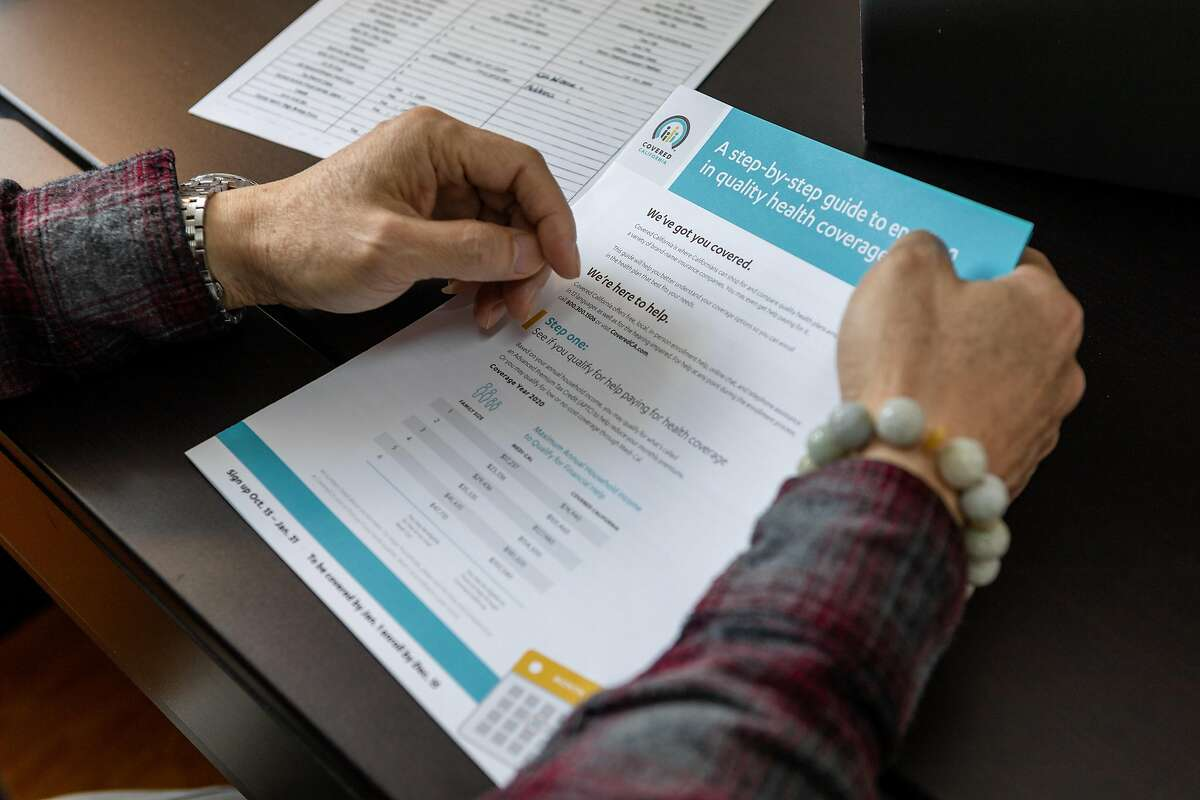 Eason Lee reads the federal government income guideline at Isabella Ku�s office on Friday, Jan. 24, 2020, in San Francisco, CA.