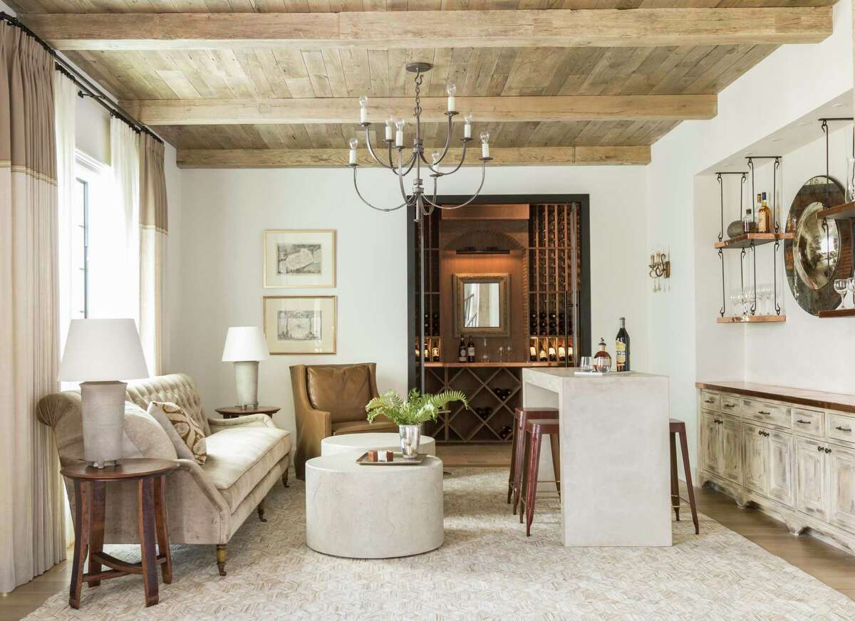 Marie Flanigan Interiors transformed a little-used formal living room into a lounge/tasting room in the League City home of James and Erin Dieter.