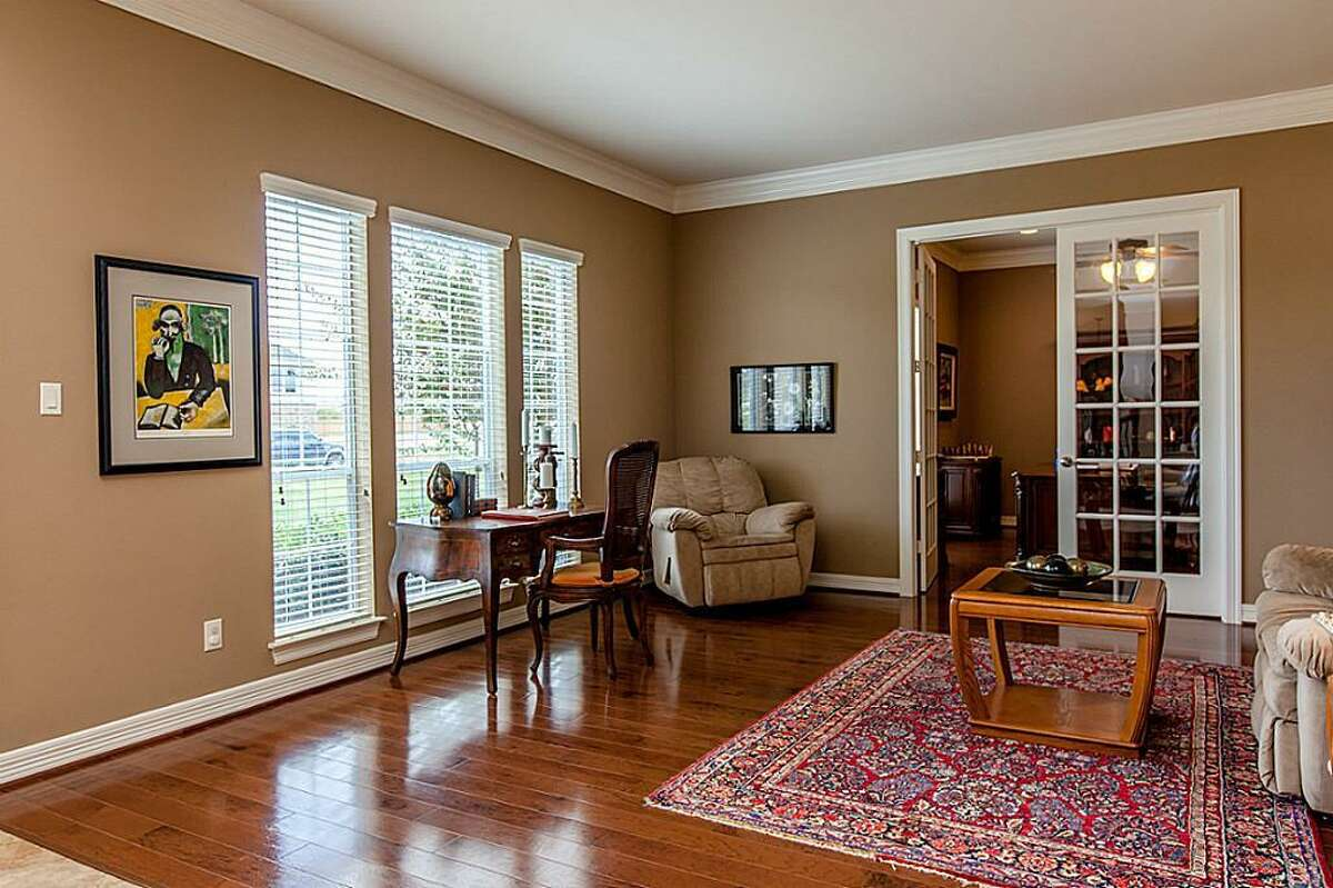 Before: That formal living room, which was rarely used, was bigger than the family room the Dieters used all of the time. Double doors in the back of the room lead to an office. Part of that room became the climate-controlled wine room at the back of the lounge.