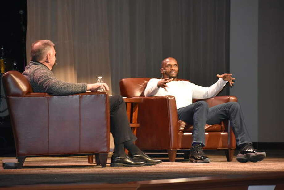 Former St. Louis Rams wide receiver and Super Bowl champion Isaac Bruce, right, speaks to the crowd during a luncheon Friday at Metro Community Church in Edwardsville. Emcee Randy Karraker, of 101.1 ESPN, is pictured on the left.