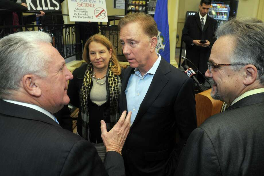 Gov. Ned Lamont speaks to Norwalk Mayor Harry Rilling following a news conference at the South Norwalk train station, in Norwalk Jan. 6. Photo: Ned Gerard / Hearst Connecticut Media / Connecticut Post