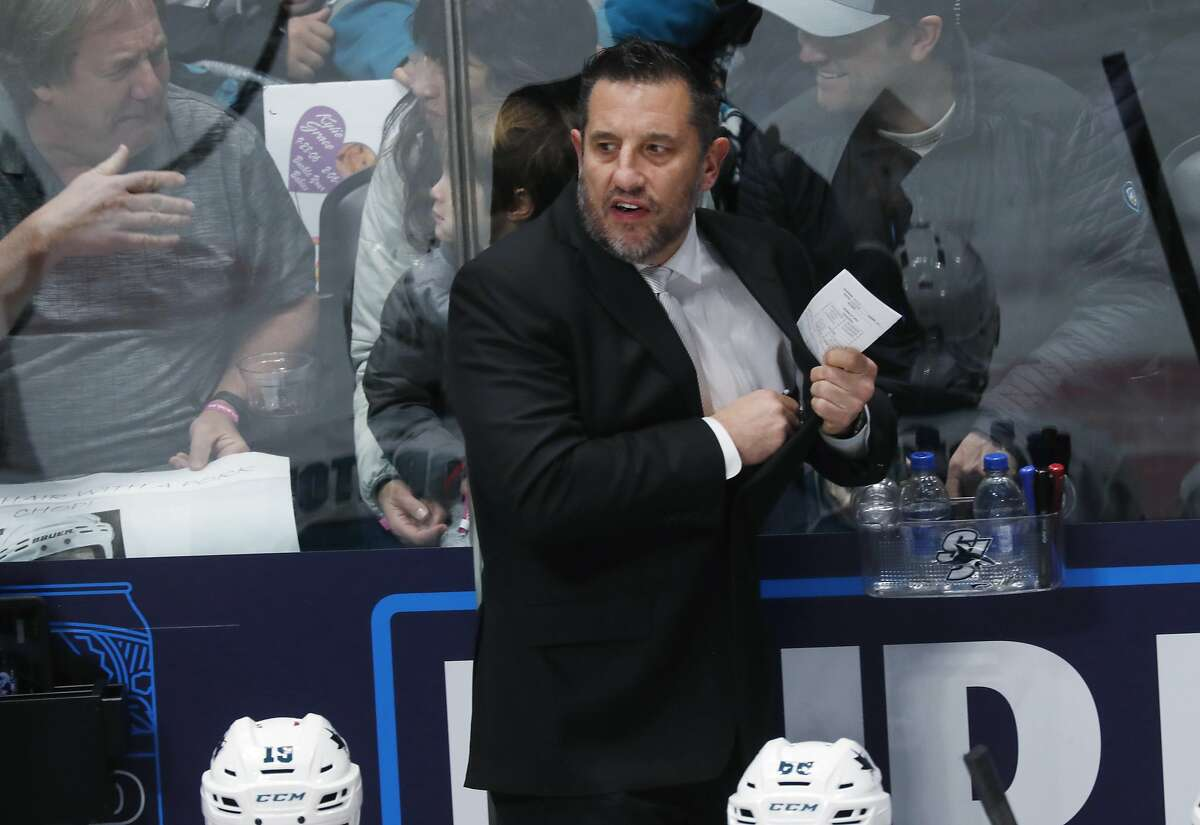 San Jose Sharks interim coach Bob Boughner directs his team against the Colorado Avalanche during the first period of an NHL hockey game Thursday, Jan. 16, 2020, in Denver. (AP Photo/David Zalubowski)