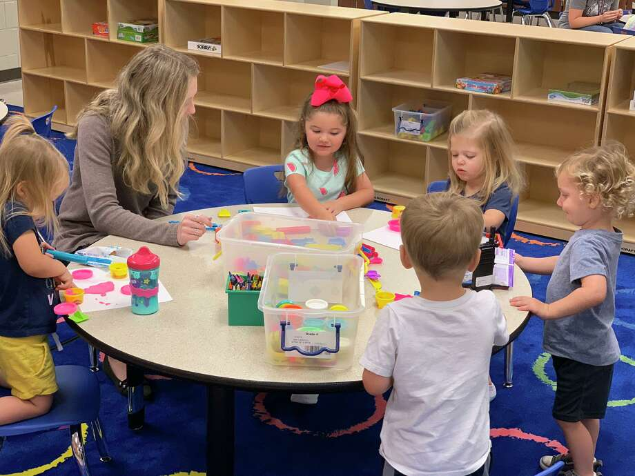 Students participate in activities at Tomball ISD's Early Excellence Academy. The program is to provide childcare for Tomball iSD students for children ages 2 to 5. Photo: Courtesy Of Tomball ISD
