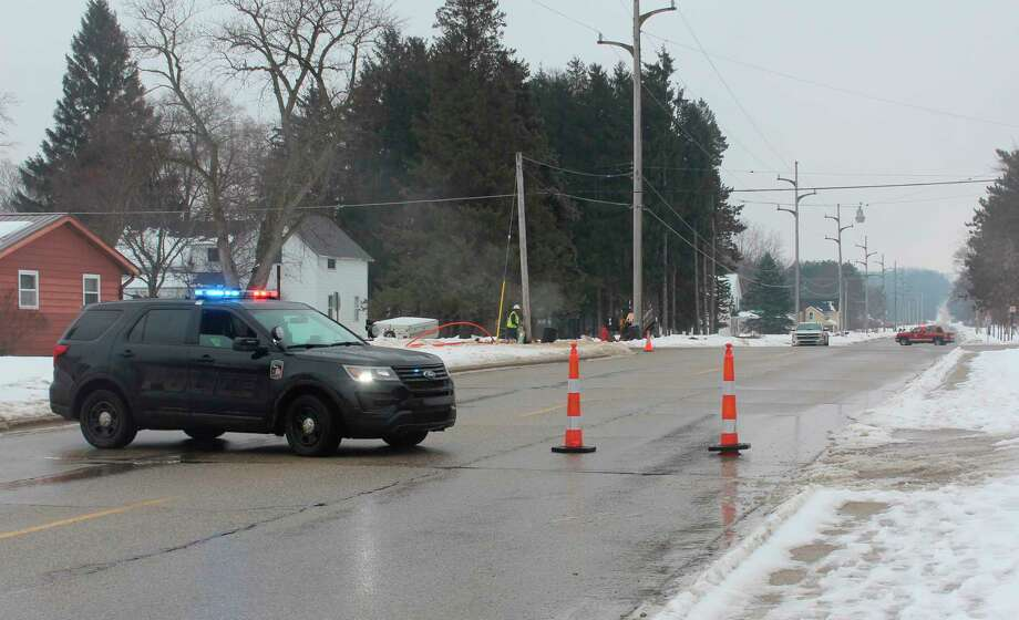 """Personnel with the Big Rapids Department of Public Safety set up traffic barricades in the area of Bjornson Street and Darwin Avenue as well as Milton and Dekrafft avenues as DTE Energy crews worked to repair a """"significant"""" gas leak Friday afternoon. (Pioneer photo/Taylor Fussman)"""