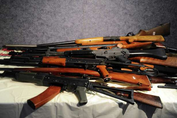 Rifles, including an AK-47, turned in during a gun buyback event sponsored by Bridgeport Police. Most people convicted of violent crimes are required to register with state officials for five years after their release from prison.