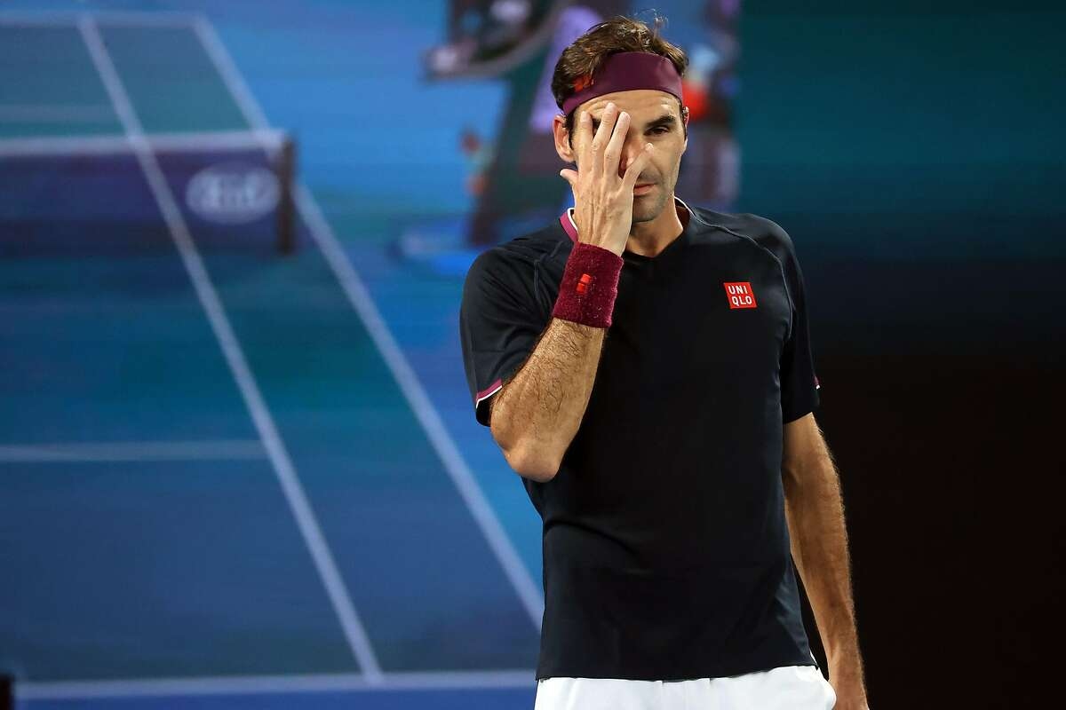 Switzerland's Roger Federer reacts after a point against Australia's John Millman during their men's singles match on day five of the Australian Open tennis tournament in Melbourne on January 24, 2020. (Photo by DAVID GRAY / AFP) / IMAGE RESTRICTED TO EDITORIAL USE - STRICTLY NO COMMERCIAL USE (Photo by DAVID GRAY/AFP via Getty Images)