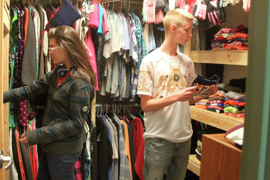 CASMAN Academy students check out the different items in their clothing pantry. School officials set up the clothing pantry with items to make sure the students have adequate clothing for the winter and other months. The school has more than a 90% free and reduced student lunch count meaning many students can't afford some of the basic clothing items. (Ken Grabowski/News Advocate)