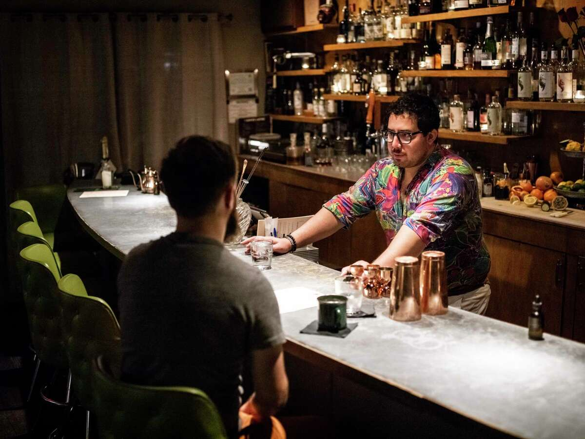 The Modernist bartender David Naylor serves a nonalcoholic drink to Erin Chase.
