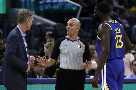 Golden State Warriors coach Stever Kerr, left, and Draymond Green (23) speak to referee Jacyn Goble after Green was called for a technical foul in the second half of an NBA basketball game against the Utah Jazz, Wednesday, Jan. 22, 2020, in San Francisco. (AP Photo/Ben Margot)