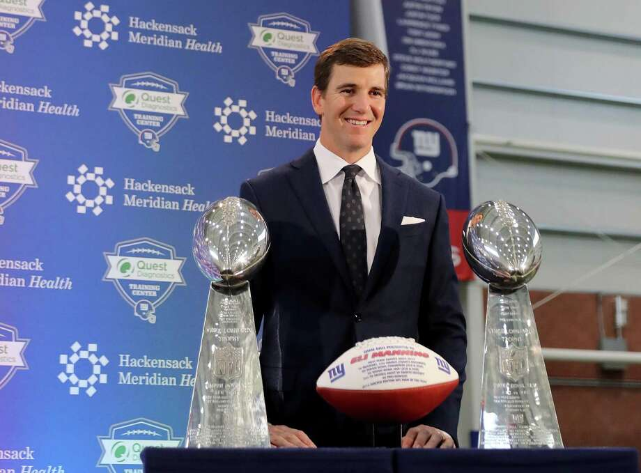 EAST RUTHERFORD, NEW JERSEY - JANUARY 24: Eli Manning of the New York Giants poses with the Vince Lombardi Trophies after a press conference to announce his retirement on January 24, 2020 at Quest Diagnostic Training Center in East Rutherford, New Jersey.The two time Super Bowl MVP is retiring after 16 seasons with the team. (Photo by Elsa/Getty Images) Photo: Elsa / Getty Images / 2020 Getty Images