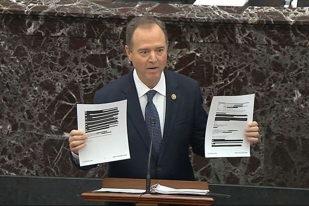 In this image from video, House impeachment manager Rep. Adam Schiff, D-Calif., holds redacted documents as he speaks during the impeachment trial against President Donald Trump in the Senate at the U.S. Capitol in Washington, Wednesday, Jan. 22, 2020.