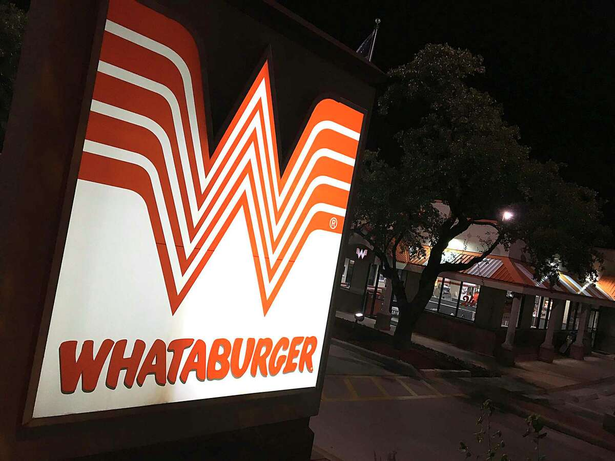 The iconic flying W marks the Whataburger on Blanco Road in San Antonio. The burger chain was named most iconic Texas brand in a recent poll.