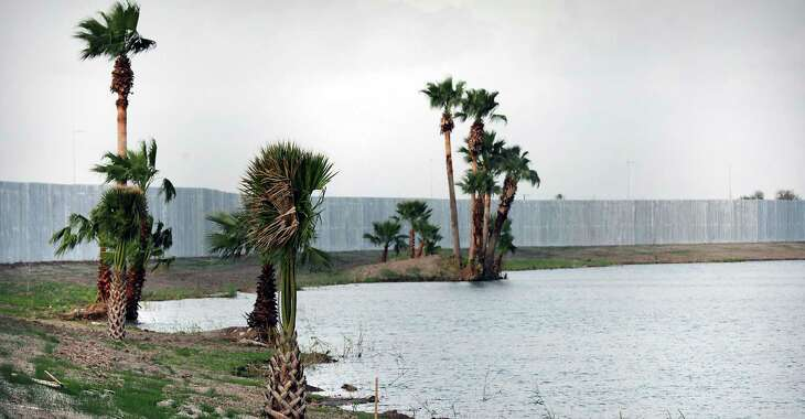 Palm trees were left along the banks of the Rio Grande where Fisher Sand and Gravel Co. is building 3 miles of border wall south of Mission, Texas.