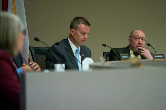 Trustees Jason Burden and Dave Rosenthal listen during the Fort Bend Independent School District school board meeting, Tuesday, Jan. 22, 2019.