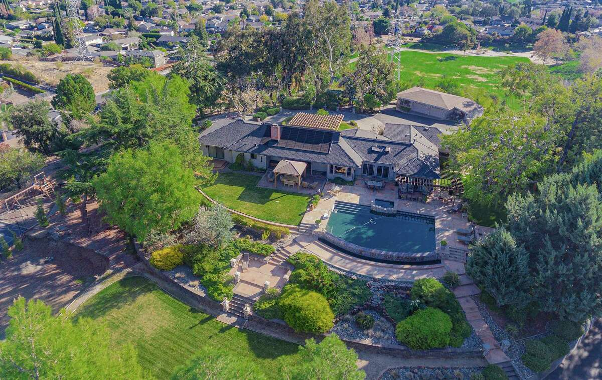 The four-bedroom, three-and-a-half-bathroom main home at 216 Hillside Road in Antioch includes a hot tub and infinity edge pool.