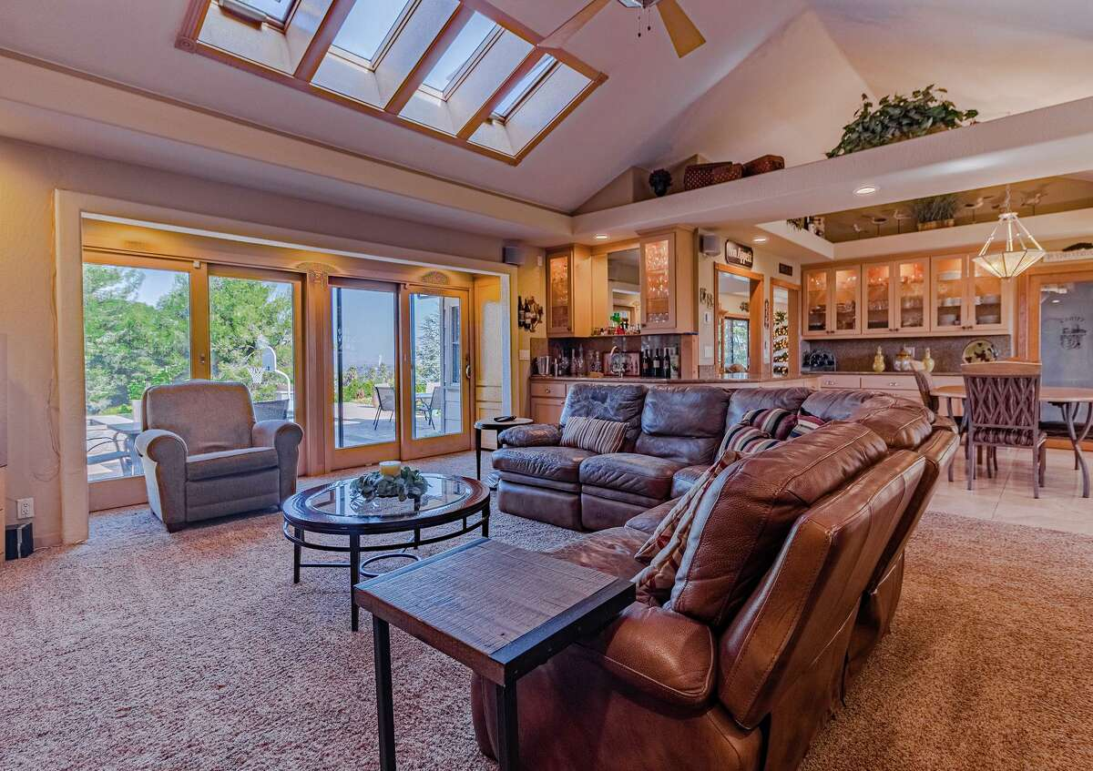 Skylights within the vaulted ceiling welcome natural light into the living room of 216 Hillside Road in Antioch, a home set on a 2.2 acre lot.