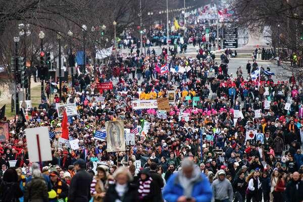 Participants of the 47th annual March for Life rally march up Constitution Ave on Friday in Washington, D.C.