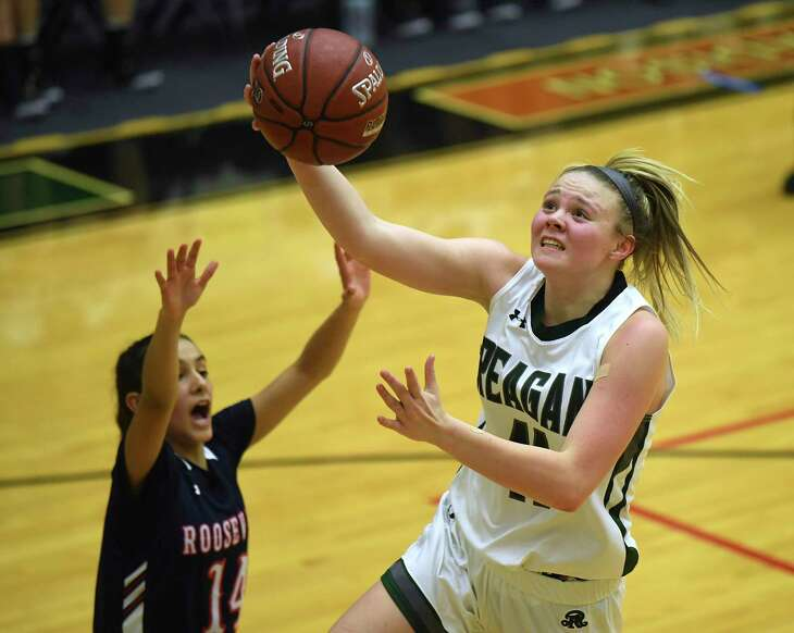Samantha Wagner of Reagan penetrates against Roosevelt during a battle of undefeated teams in District 27-6A on Wednesday, Jan. 15, 2020.