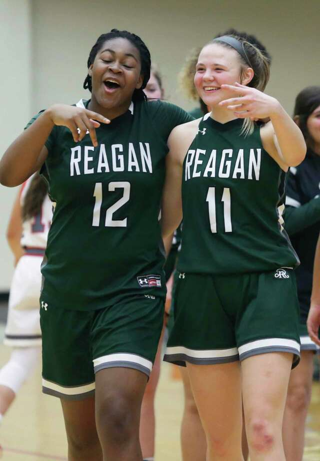 Samantha Wagner pals with Christeen Iwuala as she plays for Reagan against Lee at Littleton Gym on Jan.18, 2020. Photo: Tom Reel, San Antonio Express-News / Staff Photographer / **MANDATORY CREDIT FOR PHOTOG AND  SAN ANTONIO EXPRESS-NEWS/NO SALES/MAGS OUT/TV