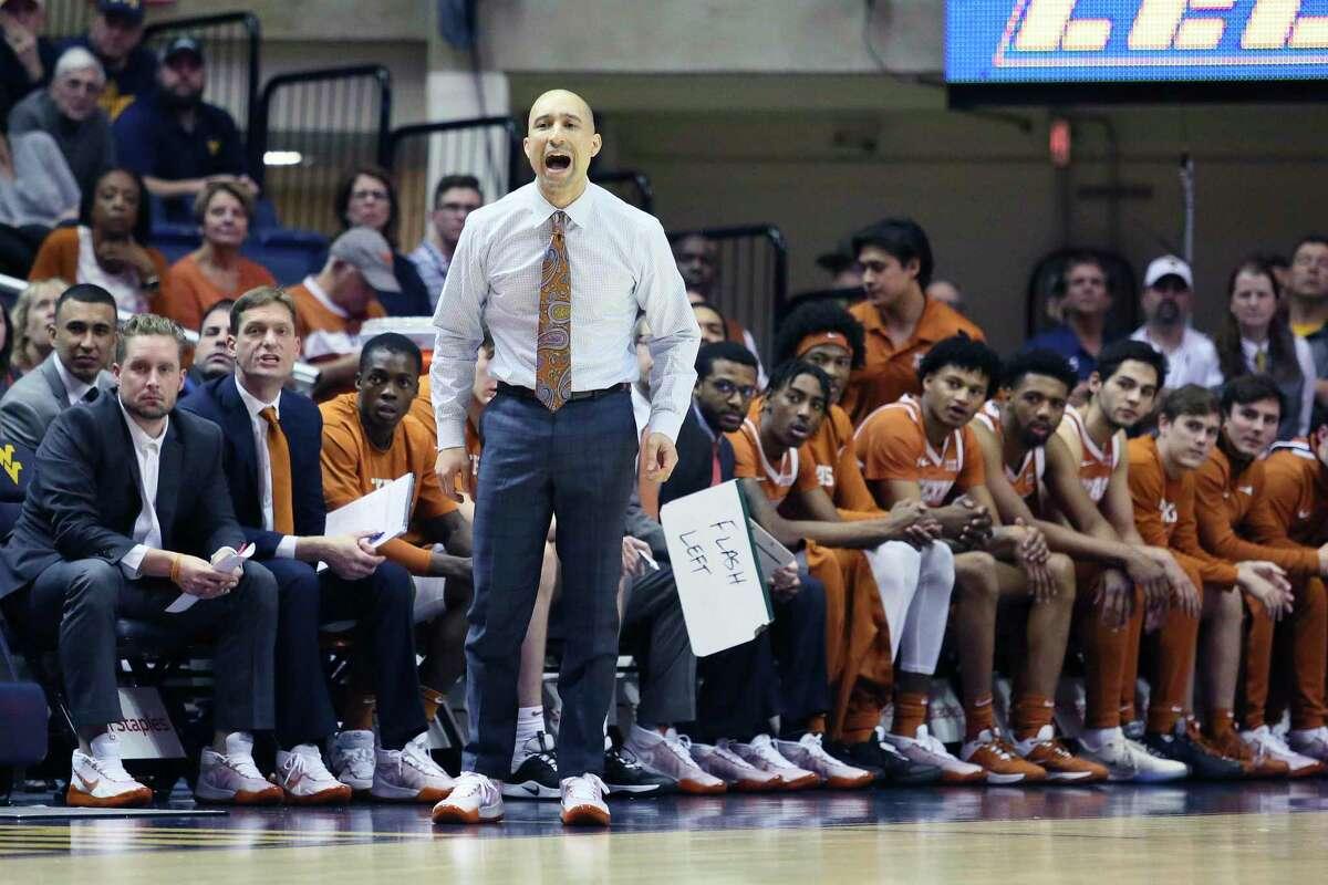 Texas coach Shaka Smart reacts during the first half of an NCAA college basketball game against West Virginia Monday, Jan. 20, 2020, in Morgantown, W.Va. (AP Photo/Kathleen Batten)