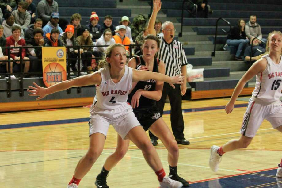 Reed City's Mackenzie Vandawater (right) gets settle to battle Big Rapids' Holly McKenna for a rebound in CSAA action last week. (Pioneer photo/John Raffel)