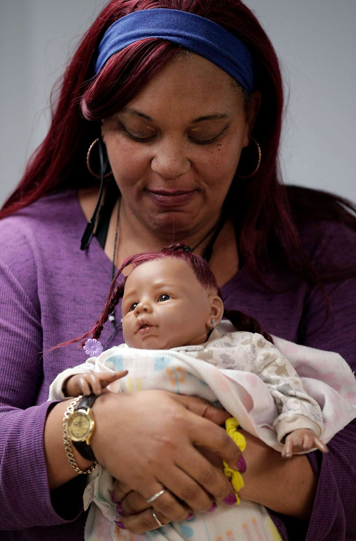 Citrina Hankins holds a baby doll at the Henry Robinson Center where she is currently a resident in Oakland, Calif., on Tuesday, January 14, 2020. Hankins will be moving out soon into more permanenet housing.