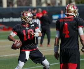 49ers quarterback Jimmy Garoppolo (10) passes during practice at 49ers headquarters on Friday, Jan. 24, 2020 in Santa Clara, Calif.