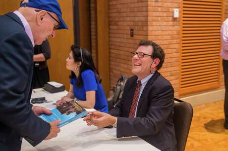 Nicholas Kristof and Sheryl WuDunn sign copies of Tightrope at an event held by the Progressive Forum on January 16, 2020, at Congregation Emanu El.