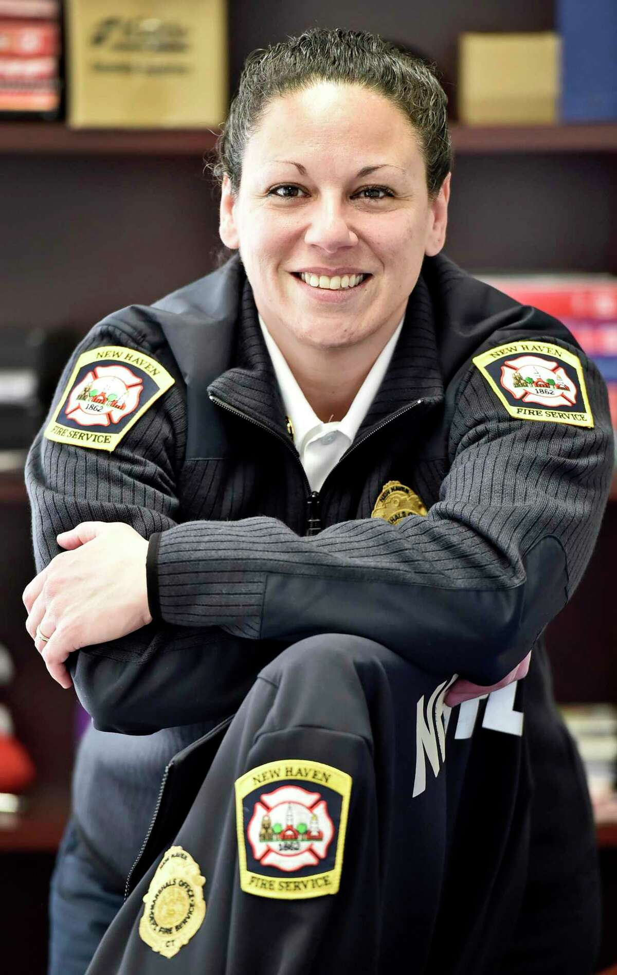 Jennifer Forslund was recently promoted to deputy fire marshal in New Haven, becoming the first woman to hold the position.