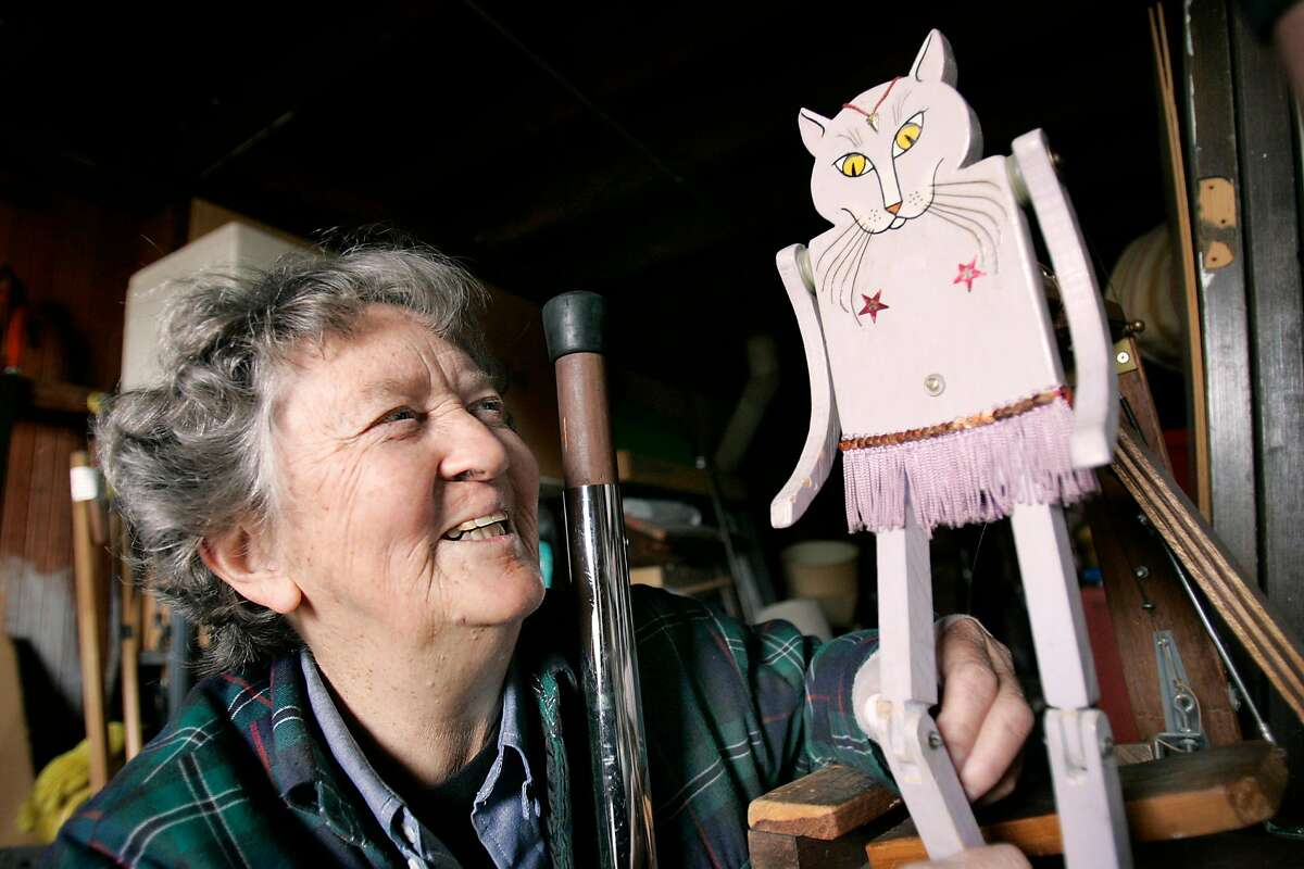 WBJONES21106_RAD.JPG SHOWN: Jackie Jones caresses her famous dancing cat at her home in San Francisco. This is a profile of Jackie Jones, 78, who has played music at the Alemany Farmers Market for many years. She is a vivid character and has many fans. Jackie recently had surgery on her thumb, and has been unable to make her weekly musical appearance, wherein she plays many instruments, including the saw. When she plays she is accompanied by her self-made dancing cat. Photo taken on 1/17/05, in SAN FRANCISCO, CA. By Katy Raddatz / The San Francisco Chronicle