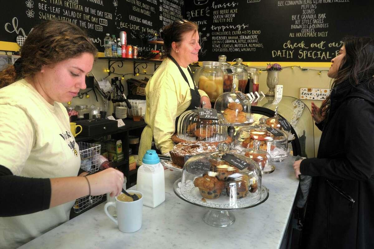 Owner Nancy Burke, center, speaks to customer at The Bee's Knees Cafe in the Walnut Beach neighborhood of Milford.