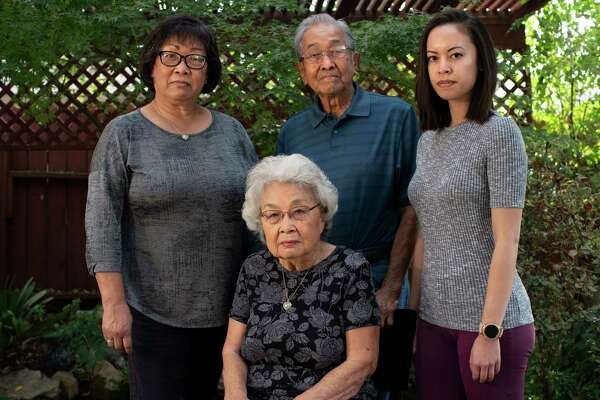 Ginny Yamamoto stands with her parents Mitsuo Yamamoto and Jayne Yamamoto, and along with her daughter Robyn Syphax within their Japanese garden in Sacramento, California.